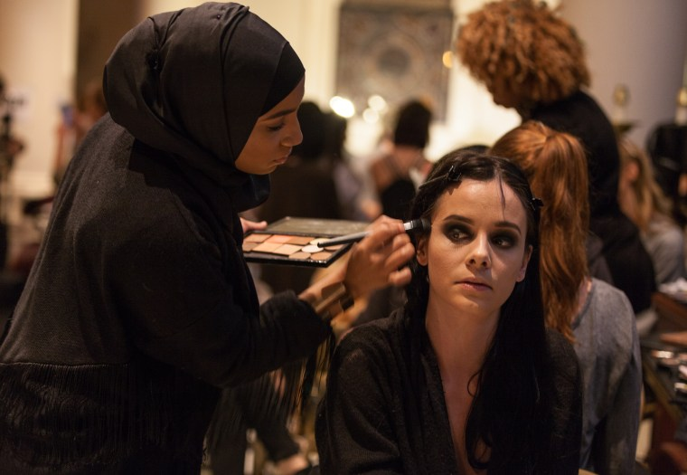 A model gets her makeup done before the fashion show benefiting Freedom Ladder, a non-profit organization aiming to prevent human trafficking.