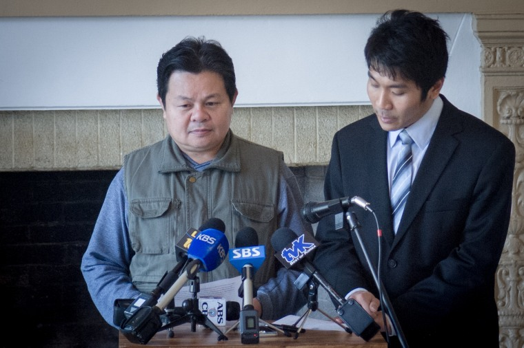 Aniwat Khadphab speaks at a press conference announcing the launch of the API Human Trafficking Task Force about his experience being trafficked at farms in Hawaii and Washington. On his right is Phatchara Udomsin, a Thai CDC attorney and translator.