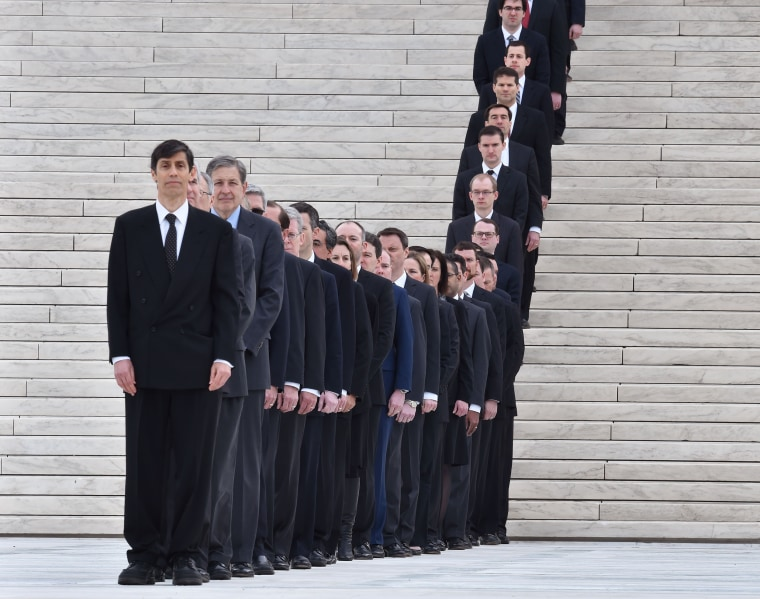 Image: A row of law clerks line up on the steps of the U.S. Supreme Court