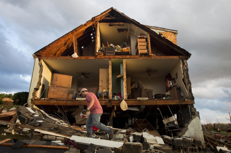 Image: Nick Mobley helps clean up a house owned by a family friend