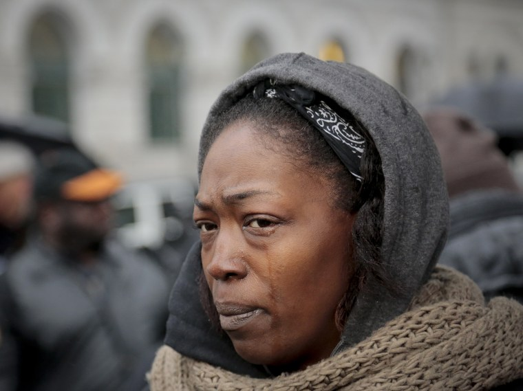 Image: Jewel Miller holds back tears during a rally