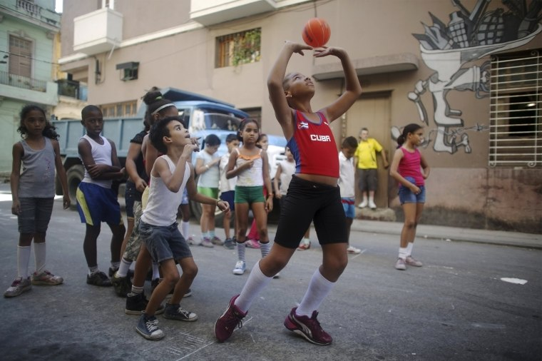 Image: Amanda Bonnell exercises with schoolmates on a street in downtown Havana