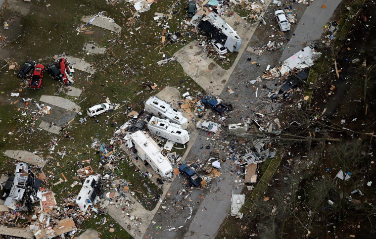 Image: A tornado reportedly flipped campers and crushed cars in the Sugar Hill RV Park