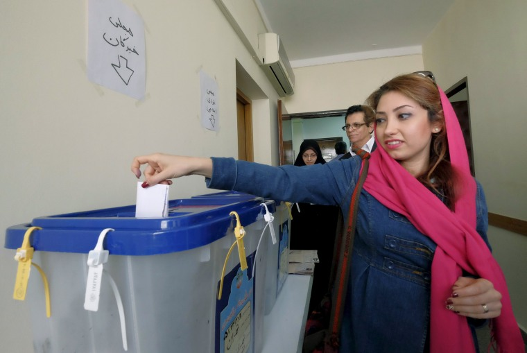 Image: Christian woman casts her ballot at a church during elections for the parliament and Assembly of Experts, in Tehran