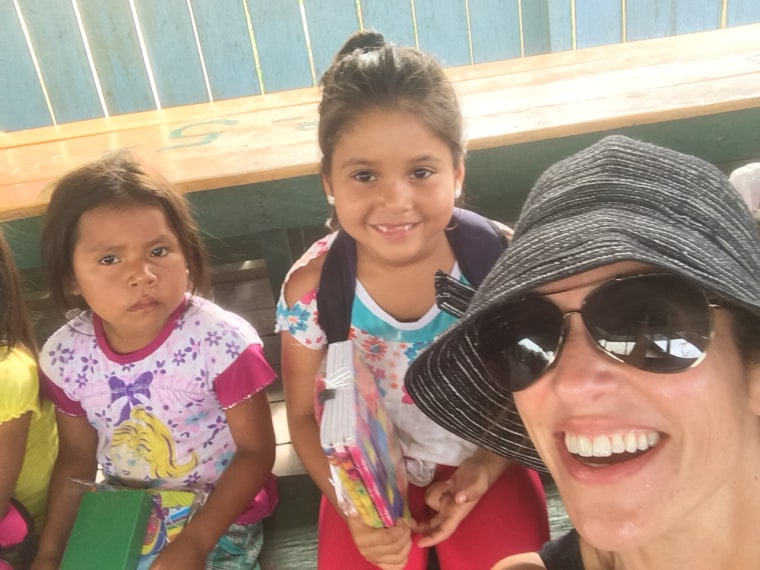 Adrianna Quintero takes a photo of herself and children in the Colombian Amazon.