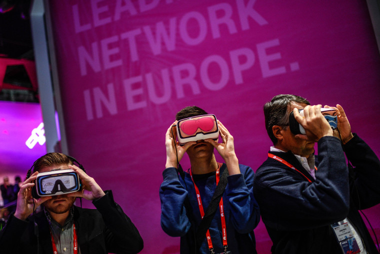 Image: Visitors use Oculus VR virtual reality devices