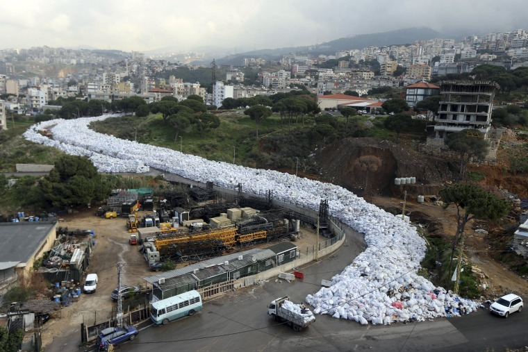 Image: A general view shows packed garbage bags in Jdeideh, Beirut