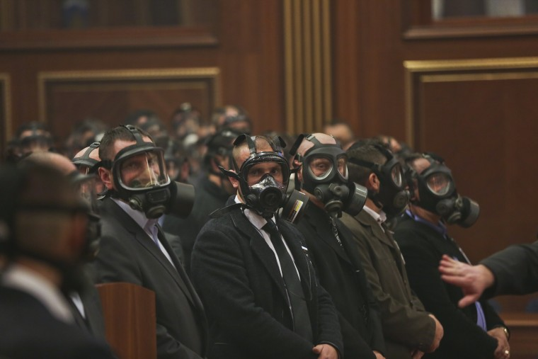 Image: Security forces wear gas masks at the Kosovo assembly on Feb. 16, 2016