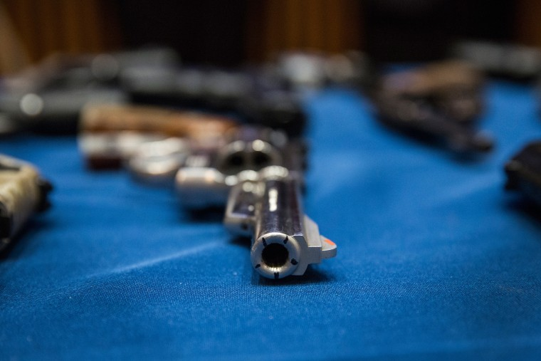 Image: Seized guns on display at a press conference