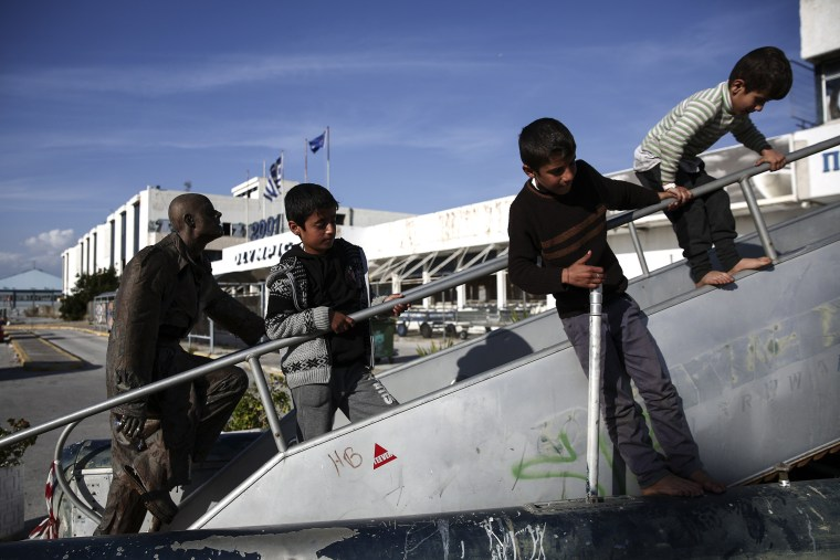 Image: Children play outside Athens' old airport