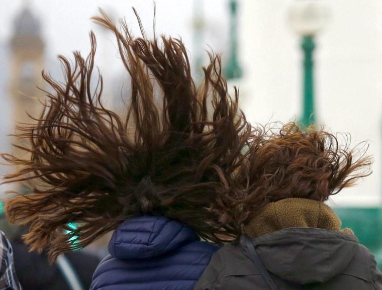 Image: Women walk during a windy weather in San Sebastian