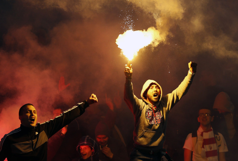 Image: Red Star soccer fans cheer during a Serbian National soccer league derby match