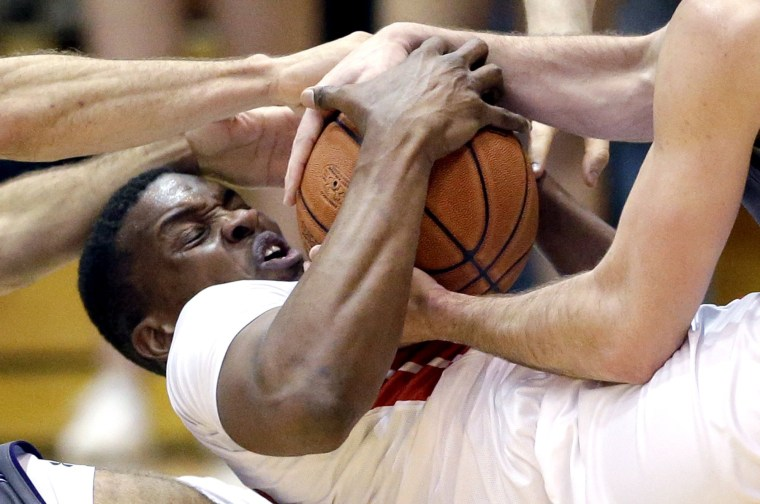 Image: Rutgers forward/center Ibrahima Diallo battles for a loose ball against Northwestern guard Tre Demps