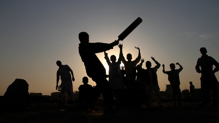 Image: Pakistani youngsters are silhouetted against sunset