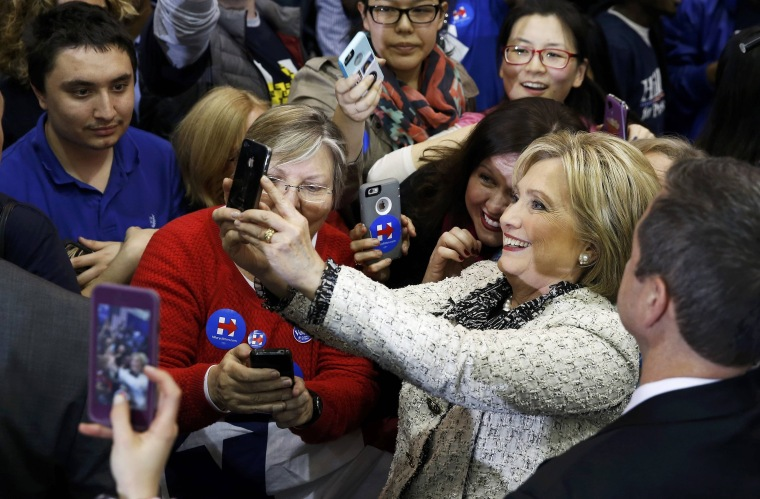 Image: Clinton takes a selfie with supporters during a primary night party in Columbia