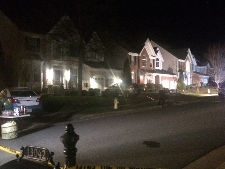 Police remain on the scene late Saturday, Feb. 27, 2016, on Lashmere Court in Dale City, Va., where three Prince William County police officers were shot responding to a domestic violence call.