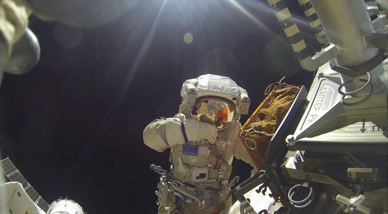 Image: International Space Station crew member Volkov performs spacewalk outside ISS