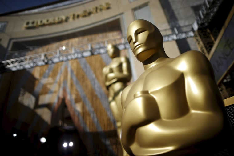 Image: Oscar statues stand at the entrance to the Dolby Theatre as preparations continue for the 88th Academy Awards in Hollywood