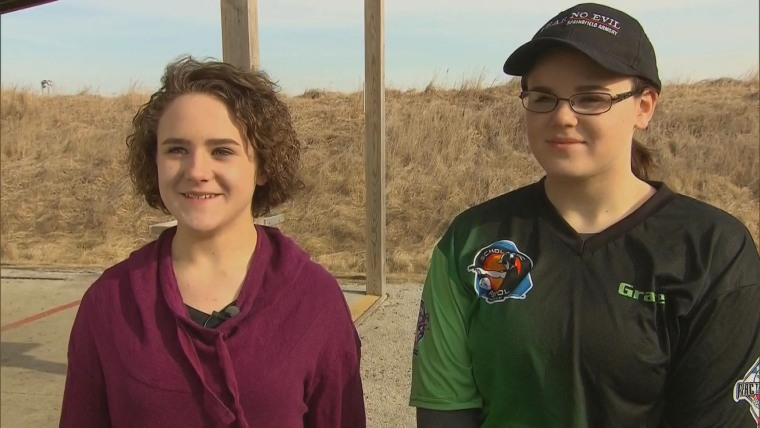 Emma (left) and Grace (right) Hood, 13 and 16 respectively, speaking at a gun range in Iowa on Thursday, Feb. 25th.