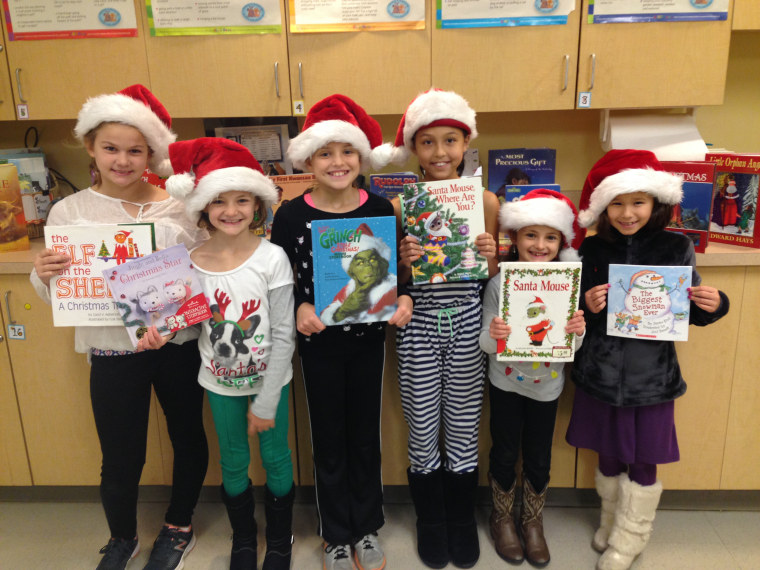 A group of the Book Buddies pose at a holiday event.