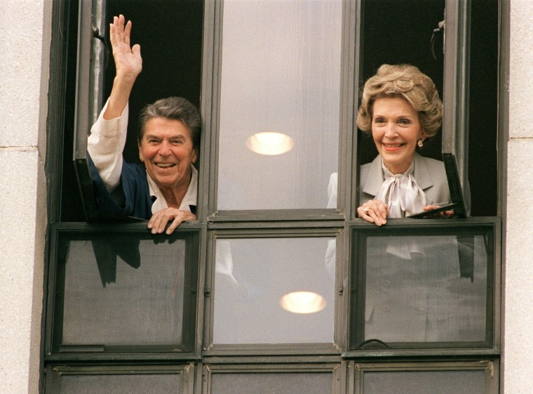 Image: President Ronald Reagan waving to the press
