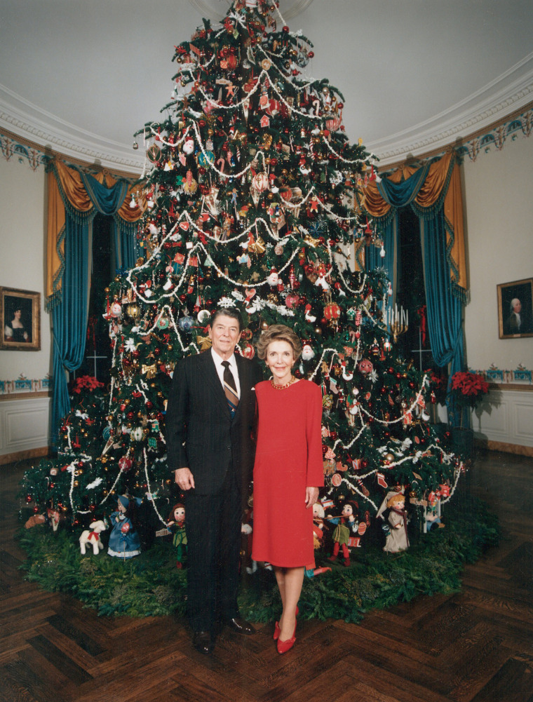 President Ronald Reagan, First Lady Nancy Reagan in front of the White House Christmas tree, 1980s