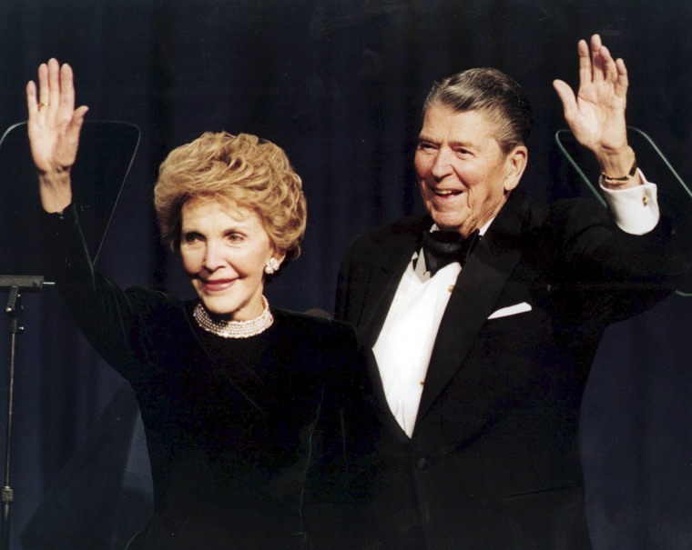 Image: President Ronald Reagan and his wife Nancy wave while attending a gala