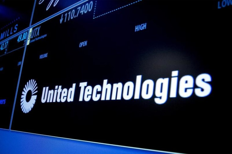 Ticker symbol for United Technologies is displayed on a screen on the floor of the New York Stock Exchange
