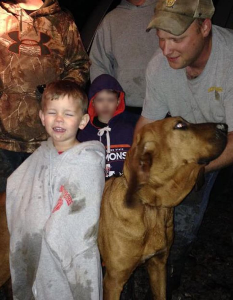 Doug Downs, his dog Honey, and three-year-old Eli.