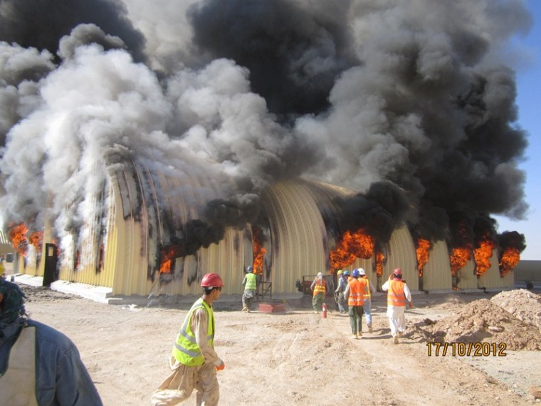 Fire breaks out at an arch-span building at the Afghan National Army's Camp Sayar in October 2012.