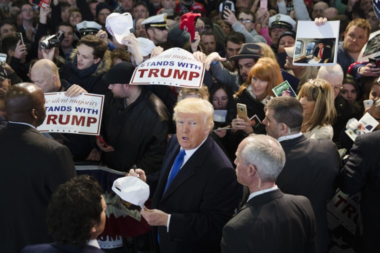 Image: Donald Trump signs autographs during a campaign stop