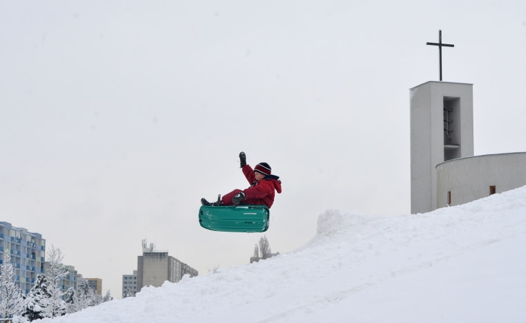Image: Prague Boy Sledding