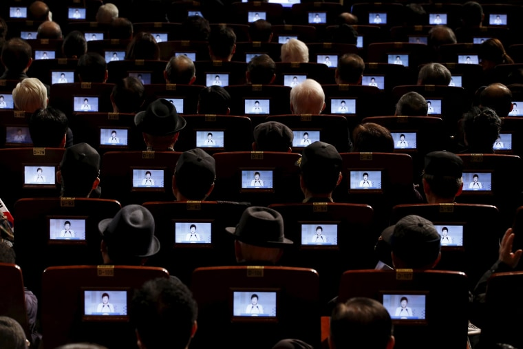 Image: South Korean President Park Geun-hye is seen on small screens fitted in seats as she delivers a speech during  a ceremony celebrating the 97th anniversary of the Independence Movement Day in Seoul