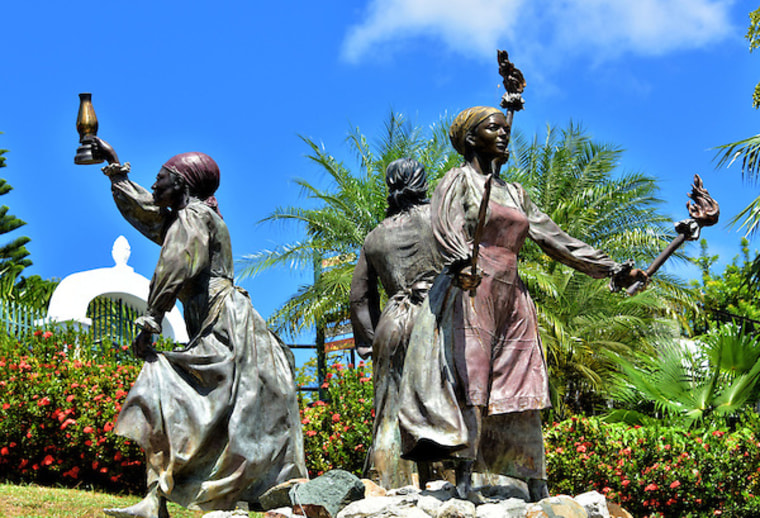 The bronze sculpture of the historic Three Queens placed in Blackbeard's Castle garden.