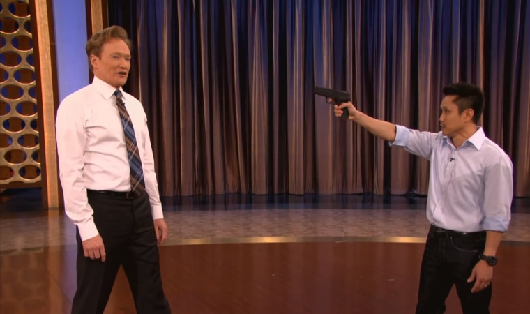 "Steven Ho teaching Conan O'Brien gun defense techniques on ""Conan."""