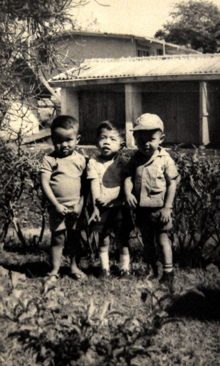 A young Steven Ho, wearing a hat on the right, in Indonesia