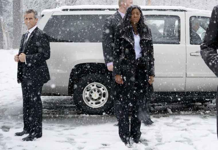Image: Secret Service agents are covered in snow