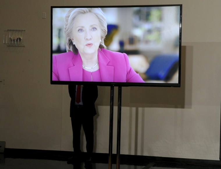 Image: A member of the U.S. Secret Service stands behind a monitor