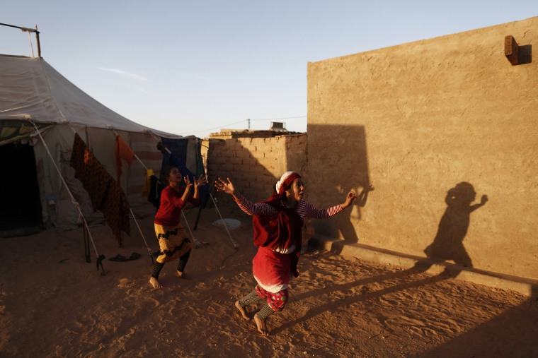 Image: Indigenous Sahrawi girls play near their tent in a refugee camp of Al Smara in Tindouf
