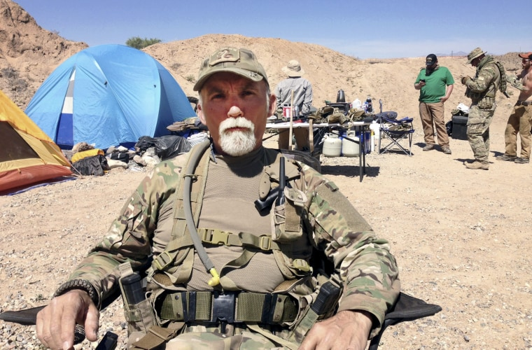 Jerry DeLemus, of Rochester, N.H., sits with a group of self-described militia members camping on rancher Cliven Bundy's ranch near Bunkerville, Nev. on April 16, 2014. Federal agents arrested DeLemus on March 3, 2016, in New Hampshire. He faces multiple federal charges in Nevada.