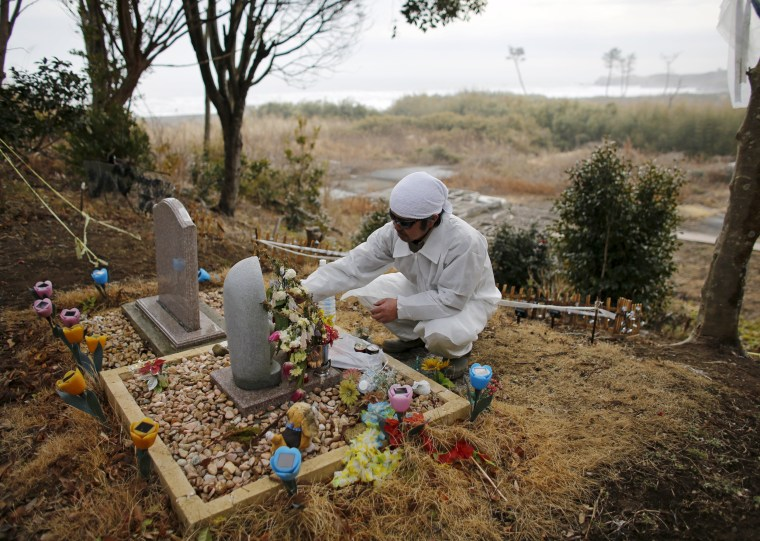 The Wider Image: Fukushima: Searching for loved ones Tomb