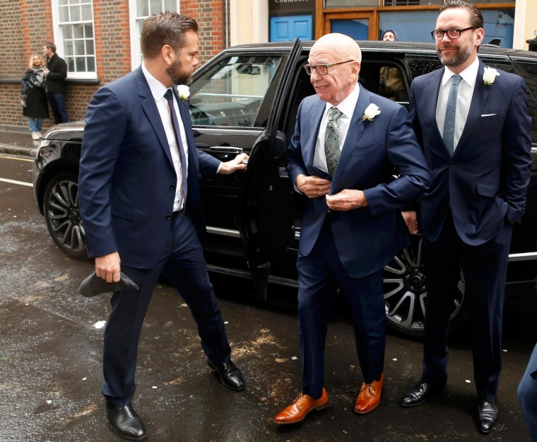 Image: Media mogul Rupert Murdoch arrives with his sons Lachlan and James at St Bride's church for a service to celebrate the wedding between Murdoch and former supermodel Jerry Hall which took place on Friday, in London