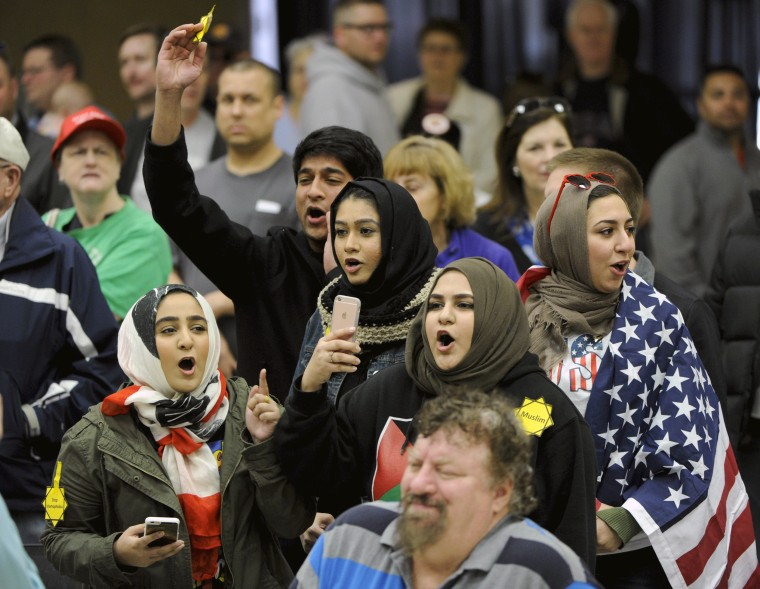 Image: Muslims protest U.S. Republican Presidential candidate Donald Trump during a rally before the Kansas Republican Caucus in Wichita, Kansas