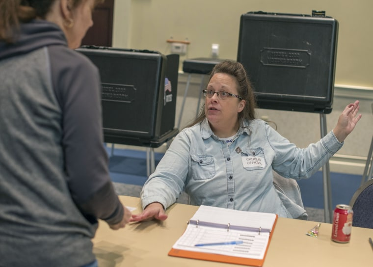 Kentucky's Rowan County Clerk Kim Davis checks in a voter while working the GOP presidential caucus in Morehead, Ky., on Saturday, March 5, 2016.