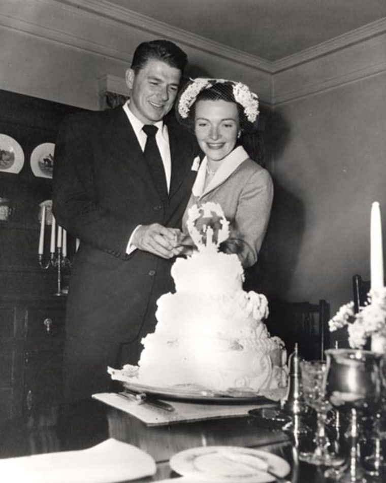 Image: Newlyweds Ronald Reagan and Nancy Reagan cut their wedding cake on March 4, 1952