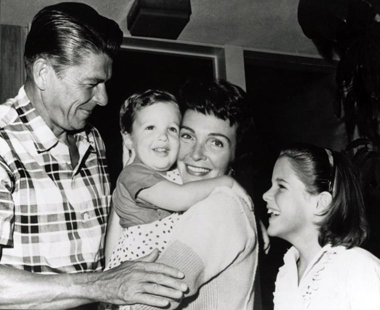 Image: Nancy Reagan holds her son, Ronald Prescott, with her husband and daughter Patti
