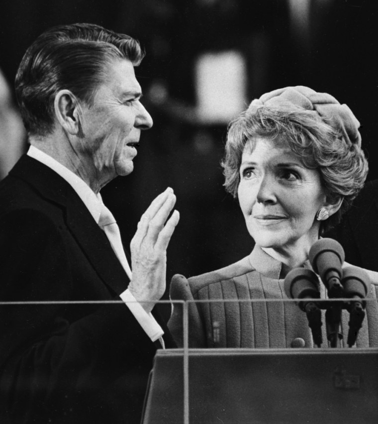 Image: Nancy Reagan proudly watches as her husband Ronald Reagan takes the oath of office Jan. 20, 1981