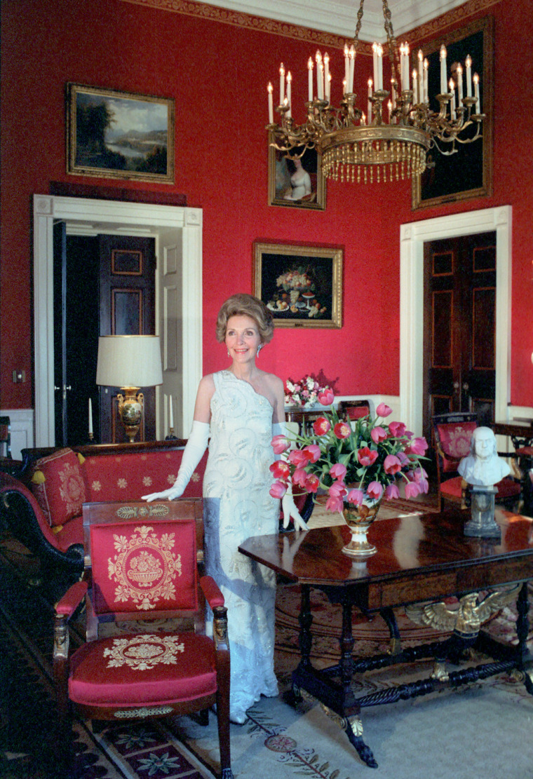 Image: Nancy Reagan poses in the Red Room during a photo session with Vogue Magazine