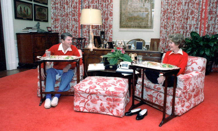 Image: The Reagans eat on TV trays Nov. 6, 1981, in the White House residence.