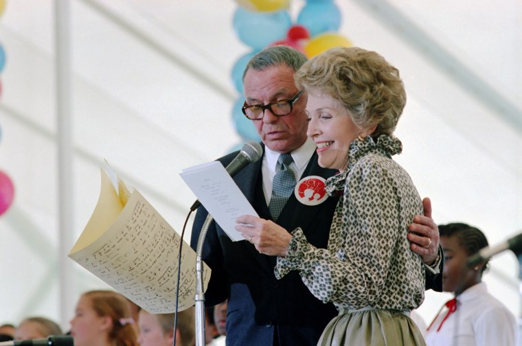 "Image: Nancy Reagan sings with Frank Sinatra at the ""To Love a Child"" Luncheon on the White House south lawn"